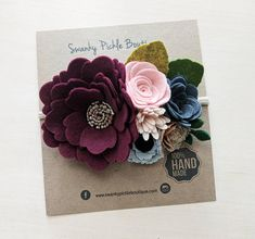 This listing is for a gorgeous mixed felt flower headband in burgundy/wine, soft shades of pink,rose gold, light and charcoal gray and black. The flowers are made with combination of 100% wool felt and wool blend felt. The flowers and leaves measure approximately 5 in length and