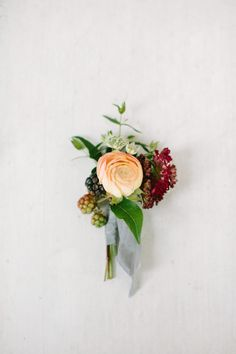 Simple grooms boutonniere with blackberries.    Incredible surprise proposal at The White Sparrow Barn in Texas. Planning and Design by Ivory & Vine Event Co.