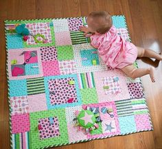 It's a girl! Treat a little princess with a handmade crib quilt that she (and mom) are sure to cuddle up with.