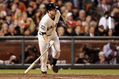 Buster Posey #28 of the San Francisco Giants hits a RBI single in the seventh inning against the Detroit Tigers during Game One of the Major League Baseball World Series at AT Park on October 24, 2012