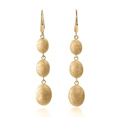 Charles Garnier Donatella graduating pebble drop earrings in silver have an 18k yellow gold finish; $195 #CharlesGarnier #dropearrings #yellowgold