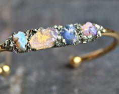 A personal favorite from my Etsy shop https://www.etsy.com/listing/253811479/opal-bracelet-raw-opal-bracelet-rough