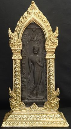 Thai Shrine Bronze Buddhist Plaque with the walking Buddha seen in many temples and shrines in Thailand. This pose is believed to protect a building from fire.