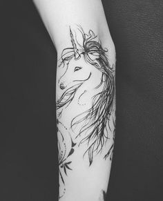 Beautifully inked unicorn tattoo on the arm. The unicorn design is shown to be in line art theme and it even showcases the unicorn's hair in strands for effect.