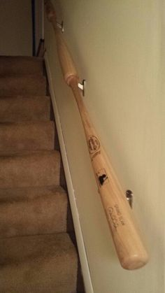 My hubby fashioned our new handrail to the basement out of baseball bats!  Love it!