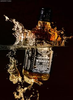 Jack Daniel's Bottle in Water #water #splash #light