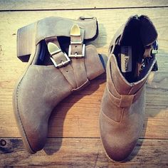 Distressed leather boots... Don't know how I feel about the gap on the side but I love the concept