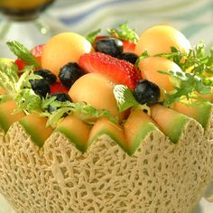 Cantaloupe Baskets - Switch out the blueberries for peaches or pineapples and I'm set.