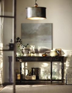 Such a great console table for displaying decorative objects and complementing wall art. HomeDecorators.com