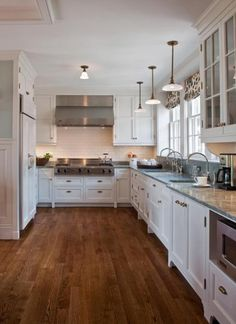Berkshires Estate Kitchen | Cultivate-I love the dark wood floors in contrast with the white cabinets.