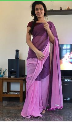 Wine coloured saree plain with a gaudy blouse