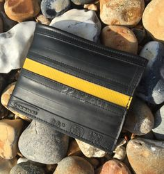 Recycled inner tube wallet. Made from a punctured inner tube with a contrasting tarpaulin stripe.