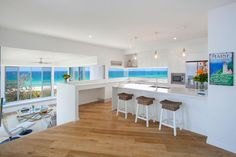 Clean modern white kitchen with straight lines.