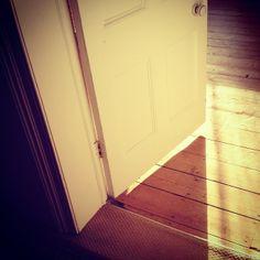The door's open. #door #open #sunshine #morning #sunday #floorboards #shadow #interior #design #interiour #original #symmetry #architecture ...