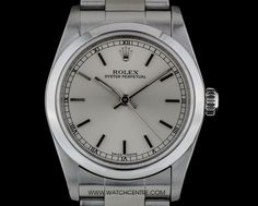 rolex stainless steel oyster perpetual silver dial mid size 77080 A Stainless Steel Oyster Perpetual Mid-Size Wristwatch, silver dial with applied white gold index batons, a fixed stainless steel smooth bezel, a - Watchcentre Rolex Oyster Perpetual, Brushed Stainless Steel, Oysters, Rolex Watches, White Gold, London, Unisex, Luxury