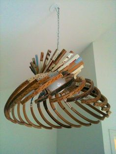 Lighting made from wooden tennis rackets. Econexishuis Zwolle. - this is wild.