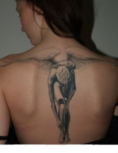 Gorgeous.. Love that it's not the typical angel wing tattoo