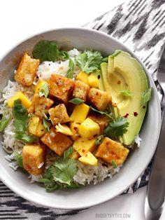 Mango Coconut Tofu Bowls with savory coconut rice and a tangy honey lime glaze. BudgetBytes.com