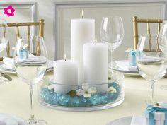 Centros de mesa para boda con velas de diferentes tamaños