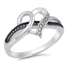 - Metal Material: .925 Sterling Silver - Ring Height: 12 mm - Stone: Synthetic Blue Synthetic Sapphire, Clear Cubic Zirconia