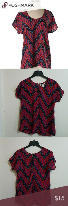 Tribal print top *Nwot* Beautiful print top from trendy brand Shrinking violet. Can be dressed up or down. Approximately 25 in. from shoulder to hem & 19.5 across. Size small, loose fit. Shrinking Violet  Tops