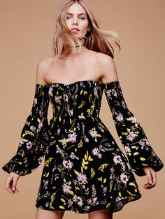 All My Lovin' Mini | In an allover floral print this American made mini dress is in an off-the-shoulder silhouette featuring a smocked elastic band at the bust. Wide sleeves with an elastic cuff.