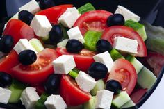 Greek salad with tomato, feta cheese, dark olives, cucumber and green peppers