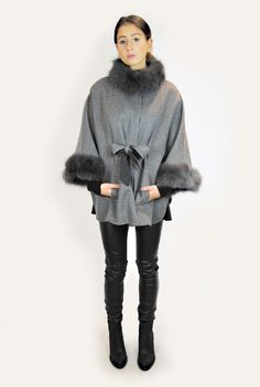This luxurious dark grey poncho from Jessimara is a special addition to your winter wardrobe. Crafted in sumptuously soft wool, this elegant black hooded poncho Grey Poncho, Hooded Poncho, Grey Fox, Fox Fur, Winter Wardrobe, Fur Trim, Cashmere, Wool, Elegant