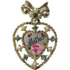 Mother Sweetheart Pin Brooch Vintage 1940s MOP Mother of Pearl Heart Drop Dangle. https://www.pinterest.com/rubylanecom/vintage-jewelry-under-25/