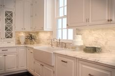 Love the Calcutta Gold Marble & Cream Kitchen.This is the backsplash and counter top I WANT!