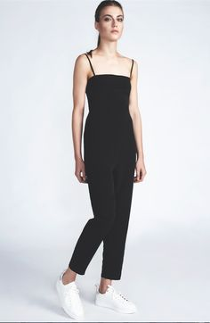 Open back crepe jumpsuit. Can be worn and styled in multiple ways with or without straps. Comes out of the black& white striped C-ya Bag. Black