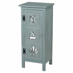 """Brimming with coastal appeal, this distressed chest features 1 shelf behind a paneled door with mirrored sea life accents.   Product: CabinetConstruction Material: MDF, wood and mirrored glassColor: BlueFeatures: One doorDimensions: 36"""" H x 16"""" W x 14"""" D"""