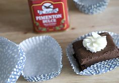 Pushing a cupcake liner on a square object gives it a square shape for brownies and such. Now why did I not think of this?