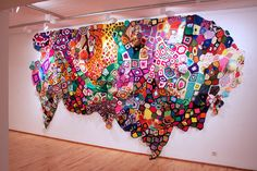 San Francisco artist Sarah Applebaum's installations and sculptures, made from afghans, vintage blankets, felt, and yarn, are so colorfully explosive and psychedelically brilliant.