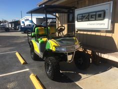 """Custom painted John Deere 2011 E-Z-GO RXV with matching custom seats, 6"""" lift, 12"""" black chrome wheels & tires, stainless steel brush guard and tops out at 27 mph!!!!"""