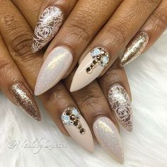 Almond shaped nails with gold/white shimmery/nude gel polishes an gold rhinestones and gold floral art. Beautiful nails by @nailsbyquetel Ugly Duckling Nails page is dedicated to promoting quality, inspirational nails created by International Nail Artists #nailartaddict #nailswag #nailaholic #nailart #nailsofinstagram #nail