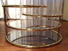 70's brass+glass coffee table  Top two levels swivel to maximize entertainment