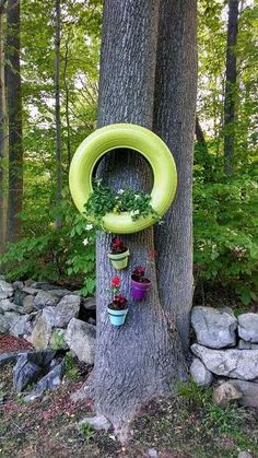 repurposed tires spray painted and turned into planters, gardening, repurposing upcycling