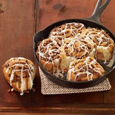 Brunch just wouldn't be the same without these yummy sweet rolls drizzled with white creamy glaze. The filling is enhanced with a layer of pecans and raisins.