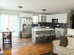 Charmant Kitchen With Stone Island And Stellar Snow Countertop