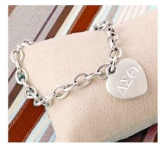 Our beautiful Mom Engraved Heart Charm Bracelet makes a loving gift for a special Mom. Perfect for Mothers Day, birthdays, or for the Mother-of-the-Bride. Delta Sigma Theta Gifts, Delta Phi, Alpha Gamma, Sigma Kappa, Delta Girl, Greek Gifts, Phi Mu, Greek Jewelry, Heart Bracelet