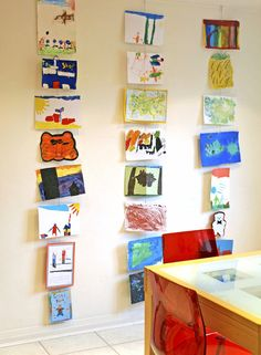 Hanging vertically gives each kid their own place to shine. | 23 Beautiful Ways To Display Your Kids' Artwork