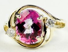 R021, Pure Pink Topaz, 10KY Gold Ring * Stone Type -Pure Pink Topaz * Approximate Stone Size - 10x8mm  * Approximate Stone Weight - 3.3 cts  * Jewelry Metal - Solid 10k Yellow Gold * Approximate Metal Weight - 3.9 grams  * Ring Size - Size selectable during checkout * Our Warranty - A full year on workmanship  * Our Guarantee - Totally unconditional 30 day guarantee