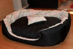 Handmade bed for medium size dogs, manually sewn and finished, made from resistant materials, size 80/64 cm, hight 23 cm, filled with silicone fluff and comfortable for any furry pets. Removable cushion with 2 sides and cover with zipper. Unique design! The rectangular shape of the bed and high margins are ideal for squatting and provides a sense of security for the pet.The bed is washable at 30 ° C.