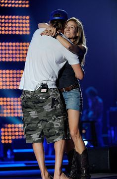 Kid Rock Photos Photos - Singers Kid Rock and Sheryl Crow perform onstage during Day 1 of rehearsals for the 2011 CMT Music Awards at Bridgestone Arena on June 7, 2011 in Nashville, Tennessee. - 2011 CMT Music Awards - Rehearsals - Day 1