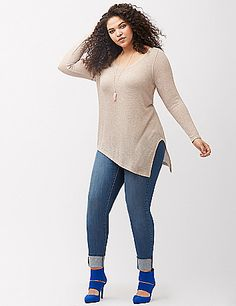 Lightweight hacci knit tunic shines up your season with a metallic open knit. Flattering scoop neck and asymmetric hem. Long sleeves. lanebryant.com