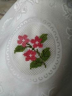This Pin was discovered by nur Small Cross Stitch, Cross Stitch Flowers, Cross Stitch Designs, Cross Stitch Patterns, Baby Embroidery, Cross Stitch Embroidery, Embroidery Patterns, Palestinian Embroidery, Knitted Flowers