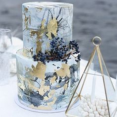 Modern wedding cakes with geometric details, contemporary flourishes, and bold colors are the newest trend in wedding cakes and wedding day desserts.