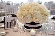 Look at the centerpiece and check out the awesome table number with the engagement photo!!!
