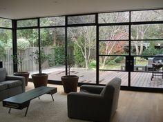 Steel windows open onto deck